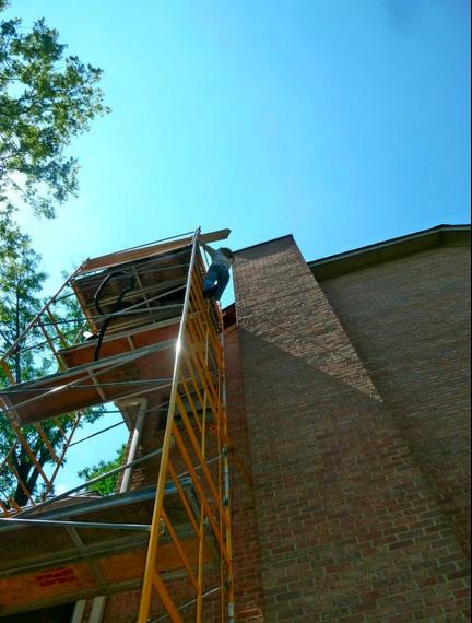 Morning sunlight glistens on the scaffolding