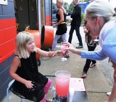 Chlo sells pink lemonade